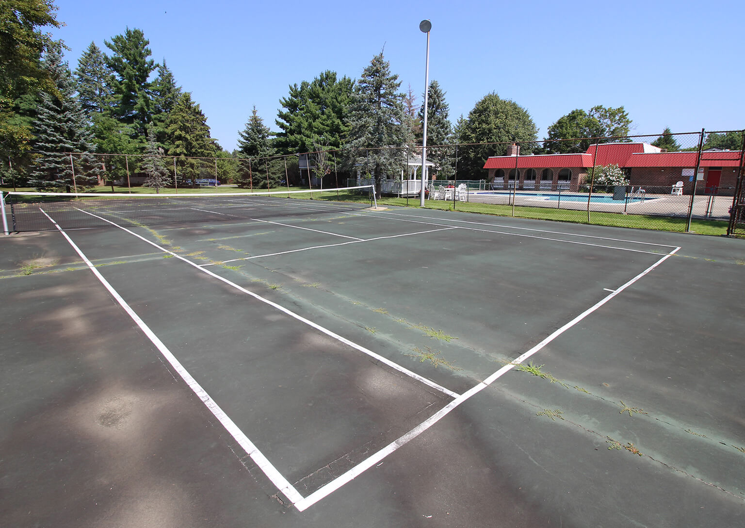 Village One Apartments - Tennis Court
