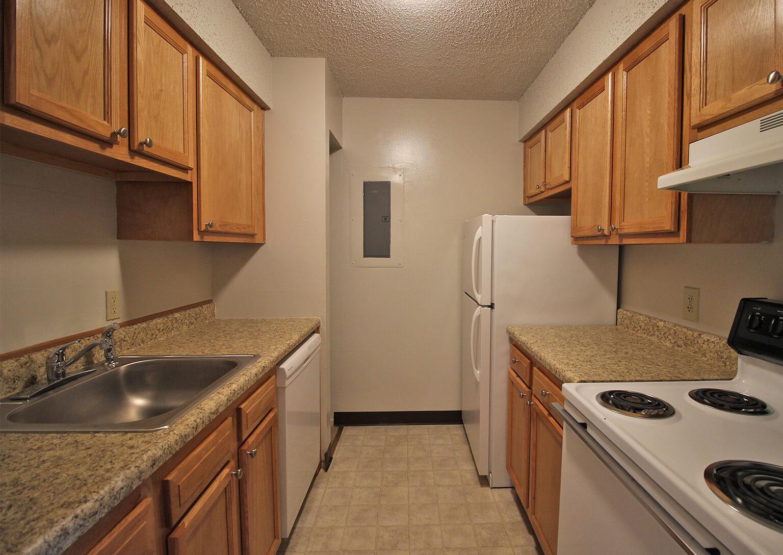 Village One Apartments - Kitchen